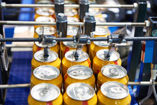 Beer can conveyor at factory stock photo