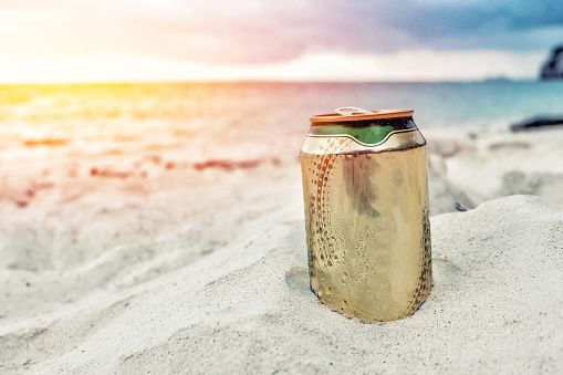 istock Beer can on the beach 882225424