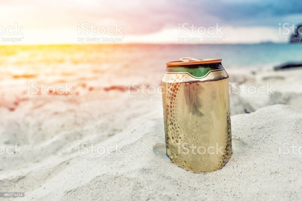 Beer can on the beach stock photo
