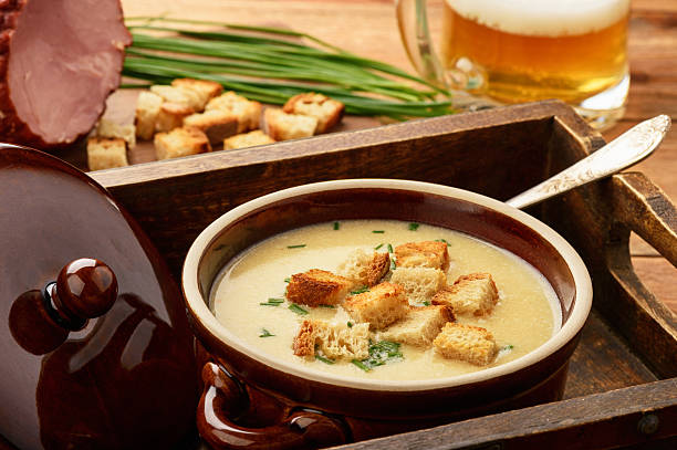 Beer cream soup with chicken fillet, ham and cheese. stock photo