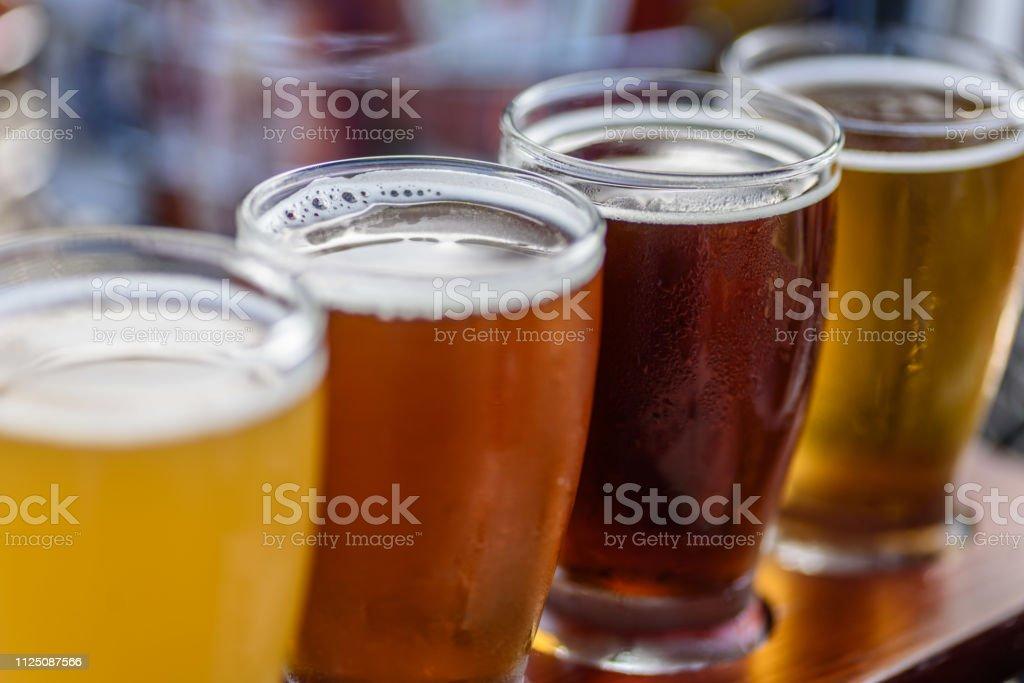 Beer flight in summer sunlight - Стоковые фото Алкоголь - напиток роялти-фри