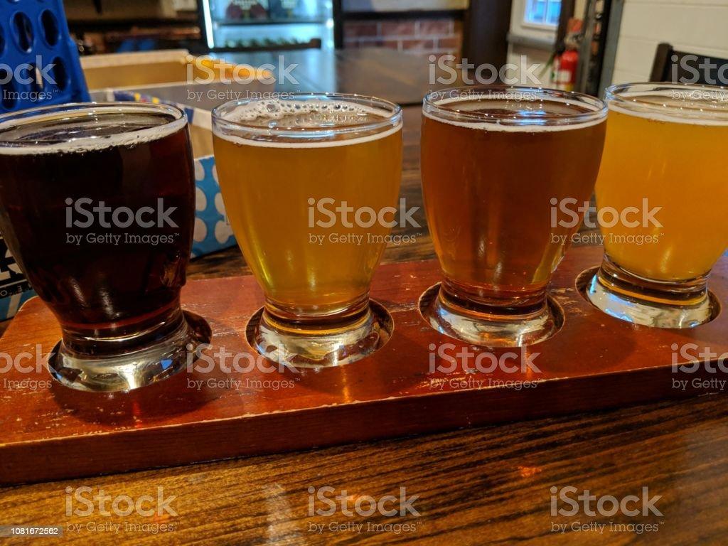 Beer flight sample flavors stock photo