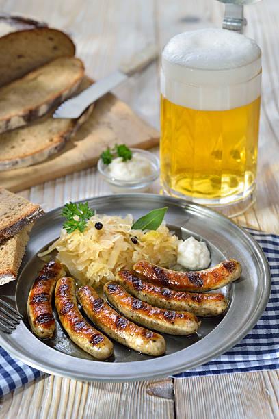 beer garden meal - bratwurst mit sauerkraut stock-fotos und bilder