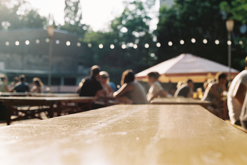 Beer garden table and people in background.