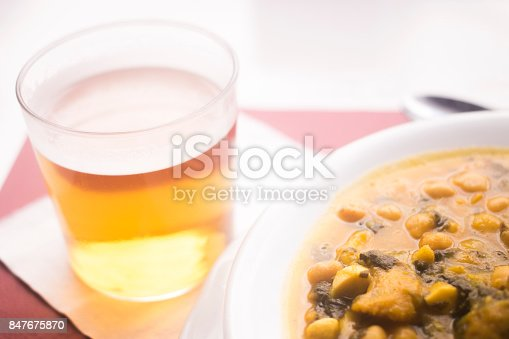 508216406 istock photo Beer glass and chicjk pea and bean Spanish tapas dish in restaurant cafe photo in Spain. 847675870
