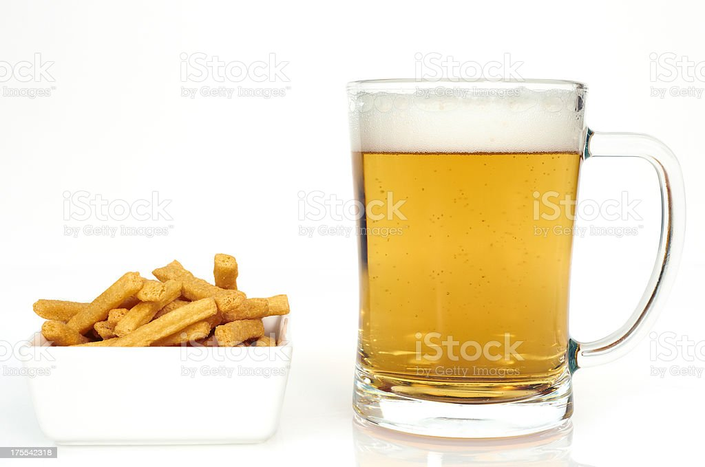 Beer glass and chips royalty-free stock photo