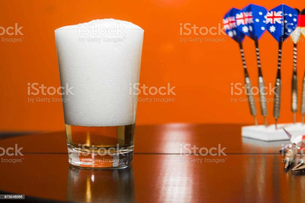 Beer glass and darts stock photo