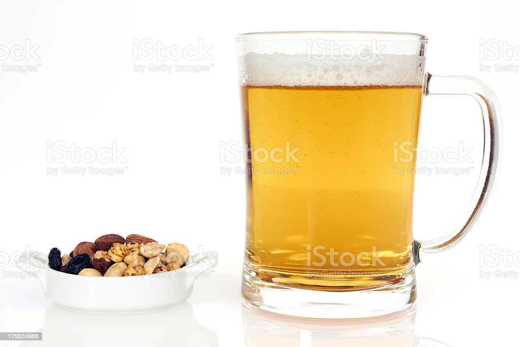 Beer glass and nuts royalty-free stock photo