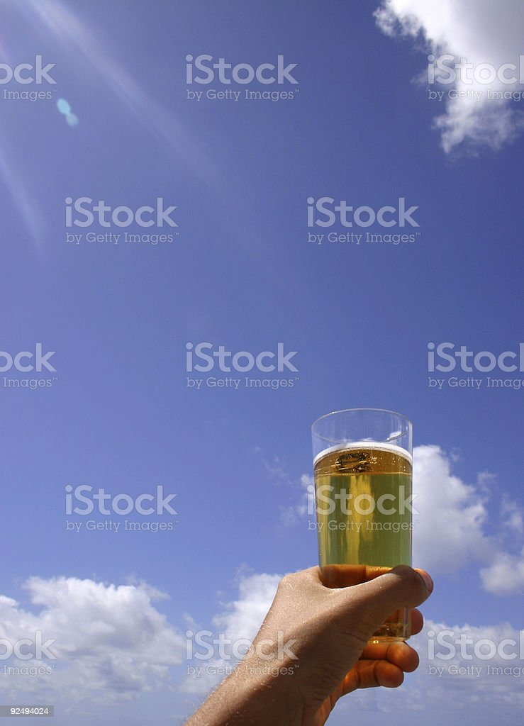 Beer Glass, Hand and Sky royalty-free stock photo