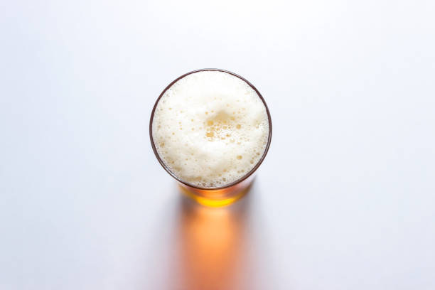 beer glass isolated on white background, top view. - , beer foto e immagini stock