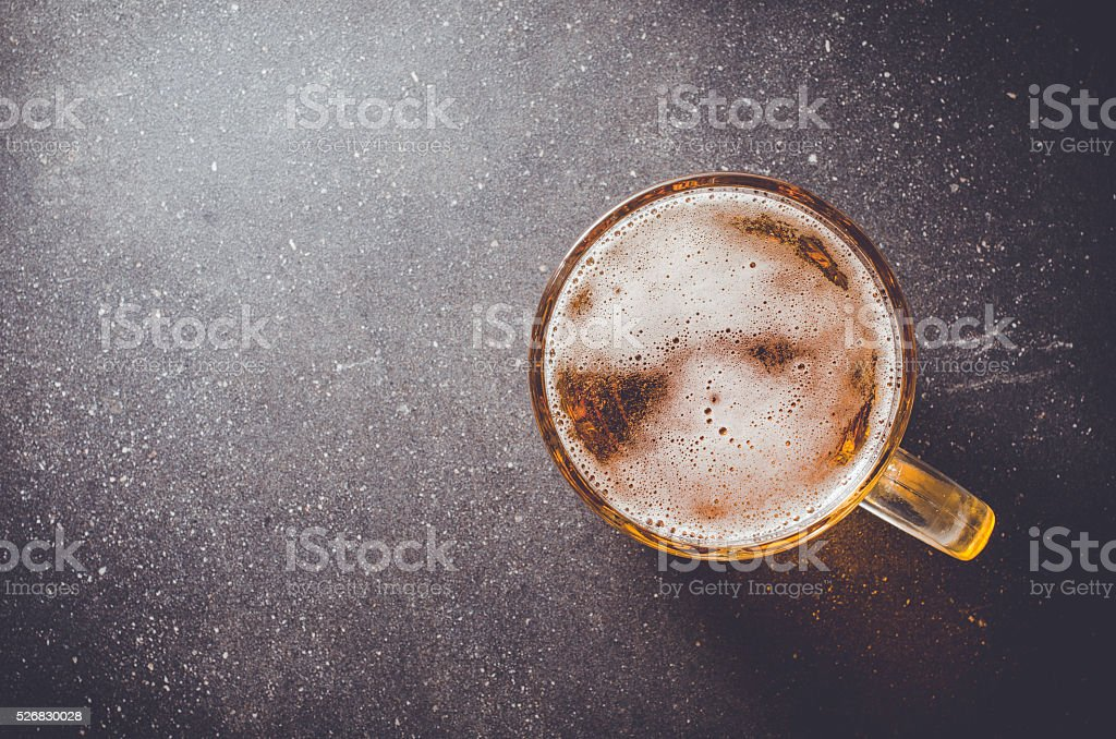 Beer glass on dark table stock photo
