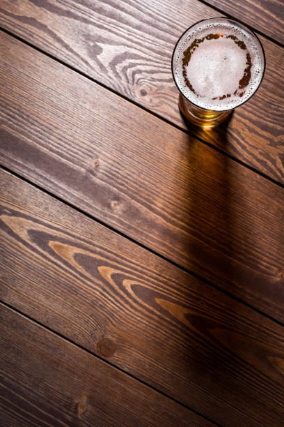 Beer glass on wooden table stock photo