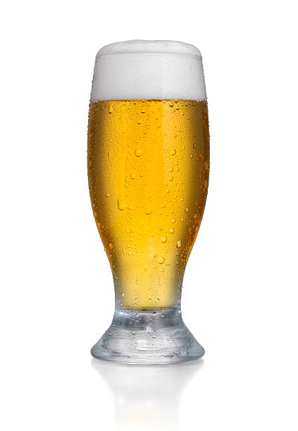 Beer Glass Glass of Fresh Beer with Foam and Bubbles on white background (+ clipping path) pilsner stock pictures, royalty-free photos & images