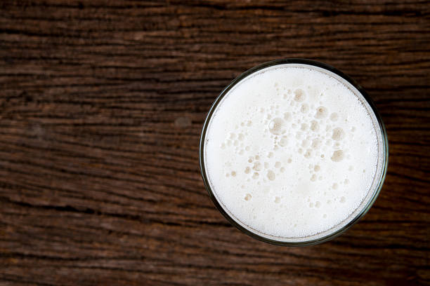beer glass - beer foam stock photos and pictures