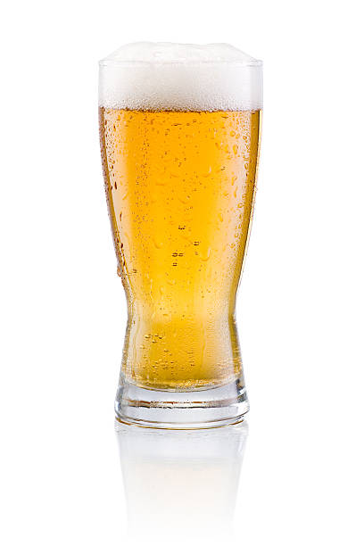 Beer glass with condensation on a white background stock photo