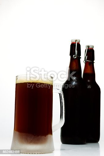 1073474208istockphoto Beer glass with dark beer and two full beer bottles on a white background 852463466