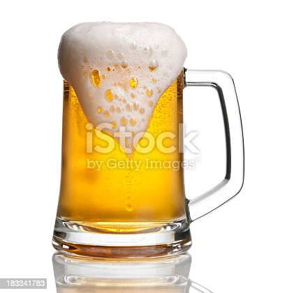 photographed overflowing beer mug with a bit of condensation. clipping path included. View more drinks