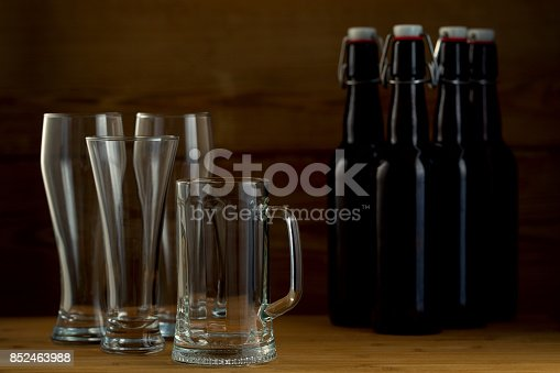 913660896istockphoto Beer glasses and beer bottles on a wooden background 852463988