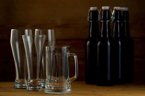 913660988 istock photo Beer glasses and beer bottles on a wooden background 852463988