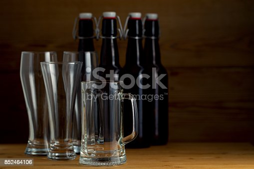 913660896istockphoto Beer glasses and beer bottles on a wooden background 852464106