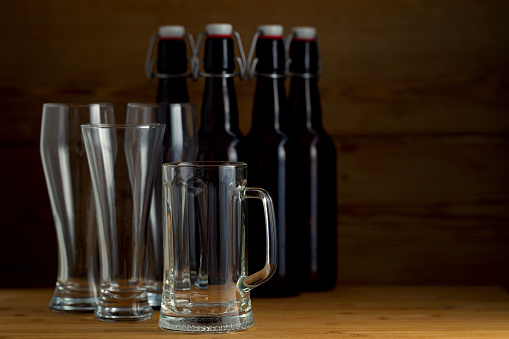 913660988 istock photo Beer glasses and beer bottles on a wooden background 852464106
