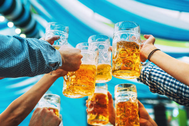 beer glasses in tent at Octoberfest in Munich stock photo