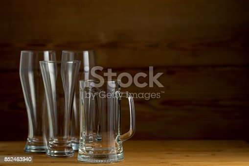 913660896istockphoto Beer glasses  on a wooden background 852463940