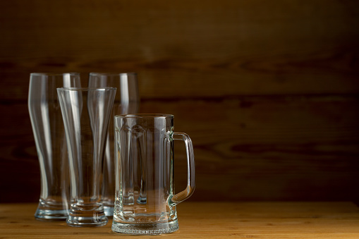 913660988 istock photo Beer glasses  on a wooden background 852463940