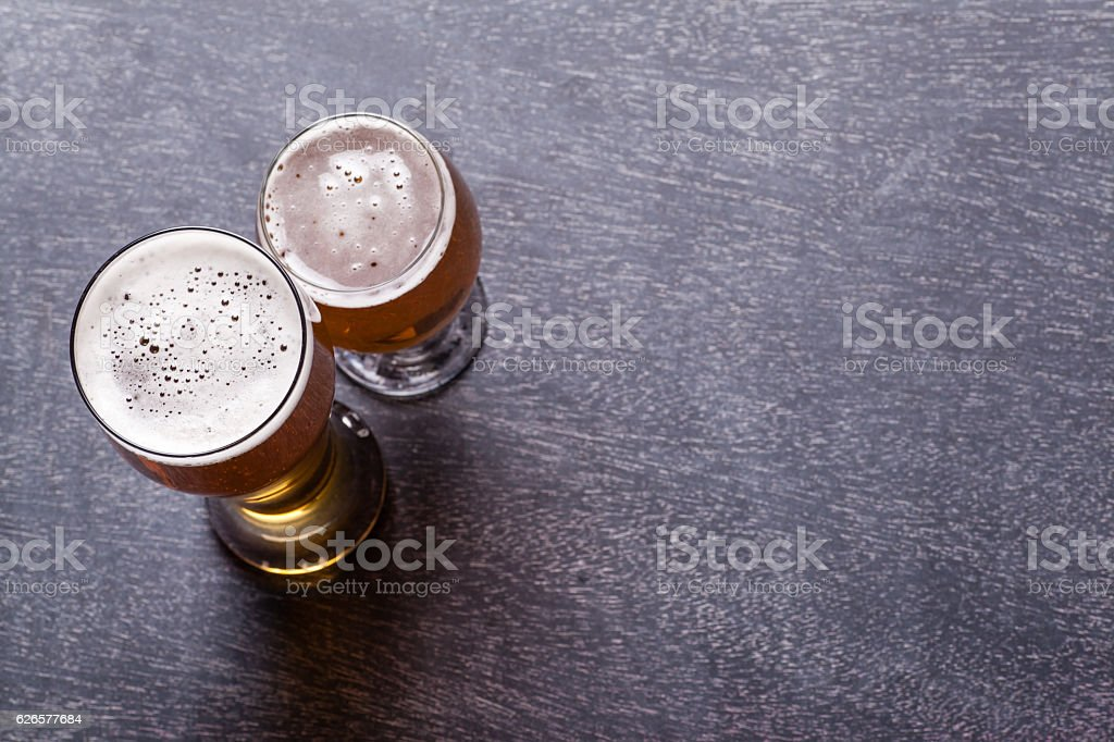 Beer glasses on blackboard stock photo
