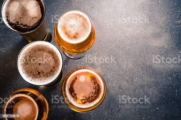 Beer glasses on dark table picture id506703878?b=1&k=6&m=506703878&s=612x612&h= cyao5zf8ysu53etjchqbxoicvlzooo4ztr6d8lbvog=