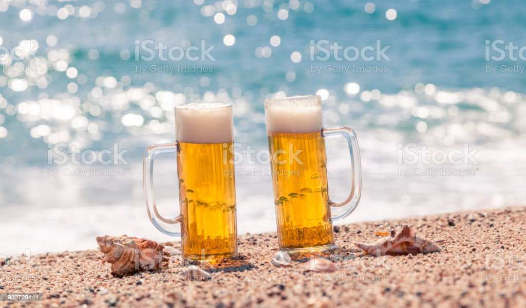 Beer glasses on the beach stock photo