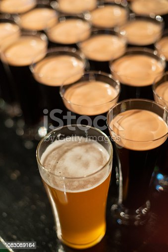 913660896 istock photo Beer glasses with dark beer are on the bar counter 1083089164