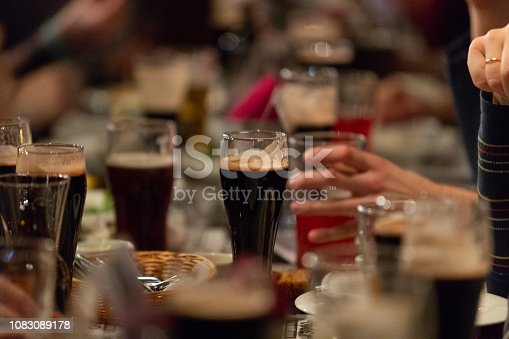 913660988istockphoto Beer glasses with dark beer are on the bar counter 1083089178
