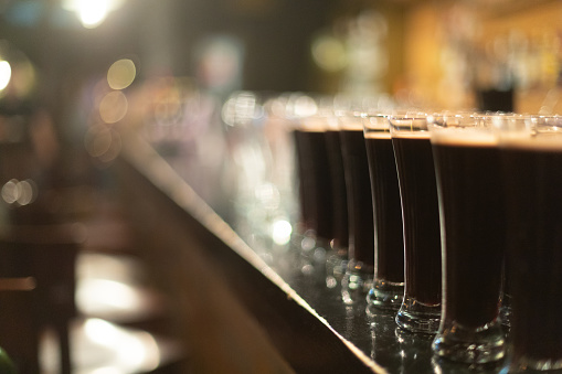 913660988 istock photo Beer glasses with dark beer are on the bar counter 1083089186