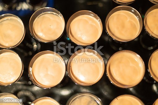 913660896 istock photo Beer glasses with dark beer are on the bar counter 1083089228