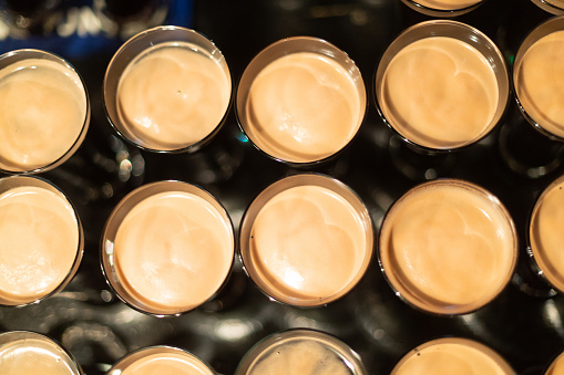 913660988 istock photo Beer glasses with dark beer are on the bar counter 1083089228