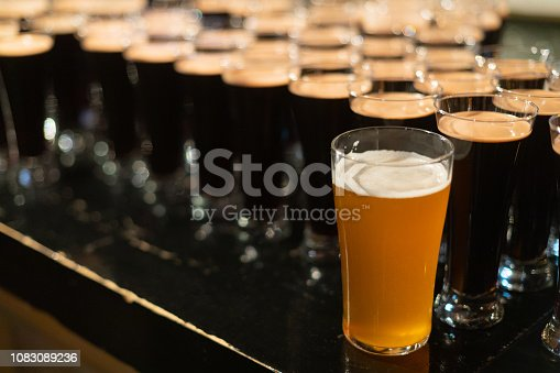 913660896istockphoto Beer glasses with dark beer are on the bar counter 1083089236