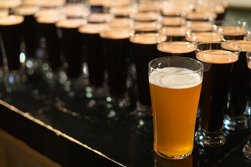 913660988 istock photo Beer glasses with dark beer are on the bar counter 1083089236