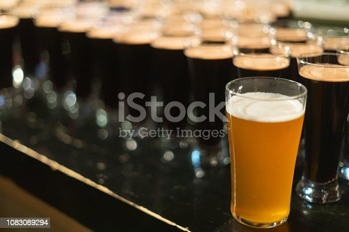 913660896 istock photo Beer glasses with dark beer are on the bar counter 1083089294