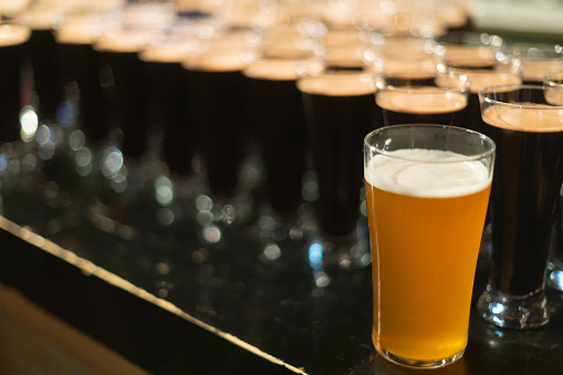 913660988 istock photo Beer glasses with dark beer are on the bar counter 1083089294