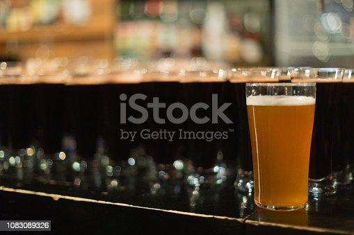913660896 istock photo Beer glasses with dark beer are on the bar counter 1083089326