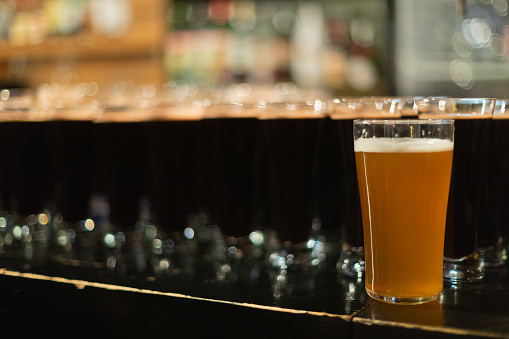 913660988 istock photo Beer glasses with dark beer are on the bar counter 1083089326