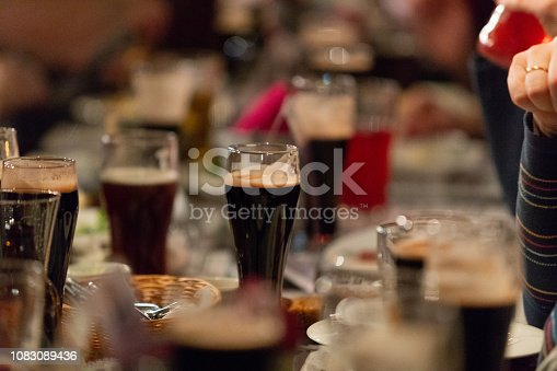 913660896 istock photo Beer glasses with dark beer are on the bar counter 1083089436