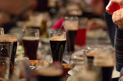 913660988 istock photo Beer glasses with dark beer are on the bar counter 1083089436