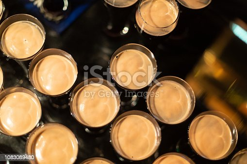913660896 istock photo Beer glasses with dark beer are on the bar counter 1083089480