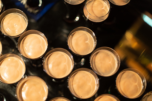 913660988 istock photo Beer glasses with dark beer are on the bar counter 1083089480