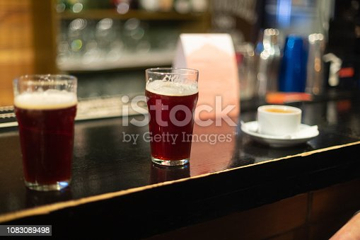 913660896 istock photo Beer glasses with dark beer are on the bar counter 1083089498