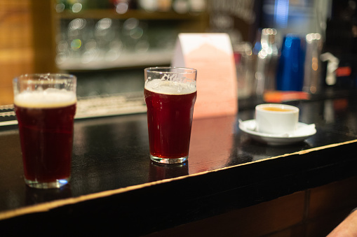 913660988 istock photo Beer glasses with dark beer are on the bar counter 1083089498