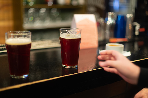 913660988 istock photo Beer glasses with dark beer are on the bar counter 1083089528