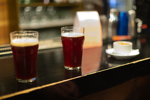 913660988 istock photo Beer glasses with dark beer are on the bar counter 1083089550